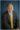 Headshot of man on blue background in Dayton.