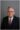 Headshot of man on gray backdrop in Dayton.
